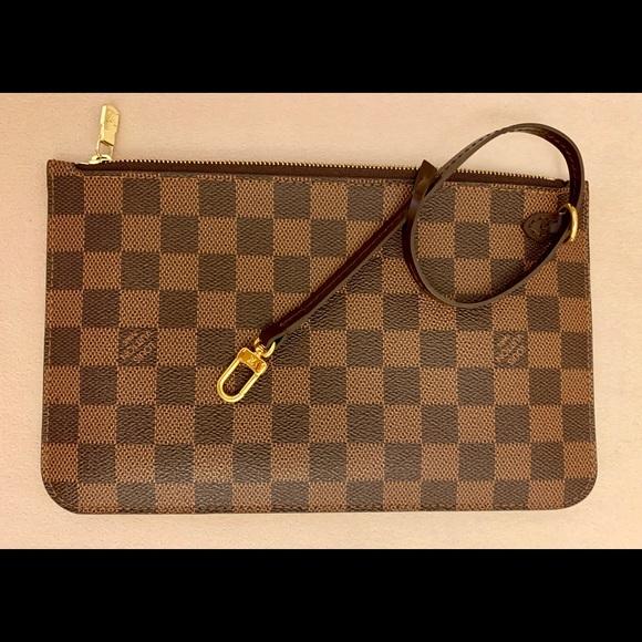 fe4d721de986 Louis Vuitton Handbags - 100% Authentic Louis Vuitton LV Neverfull Clutch